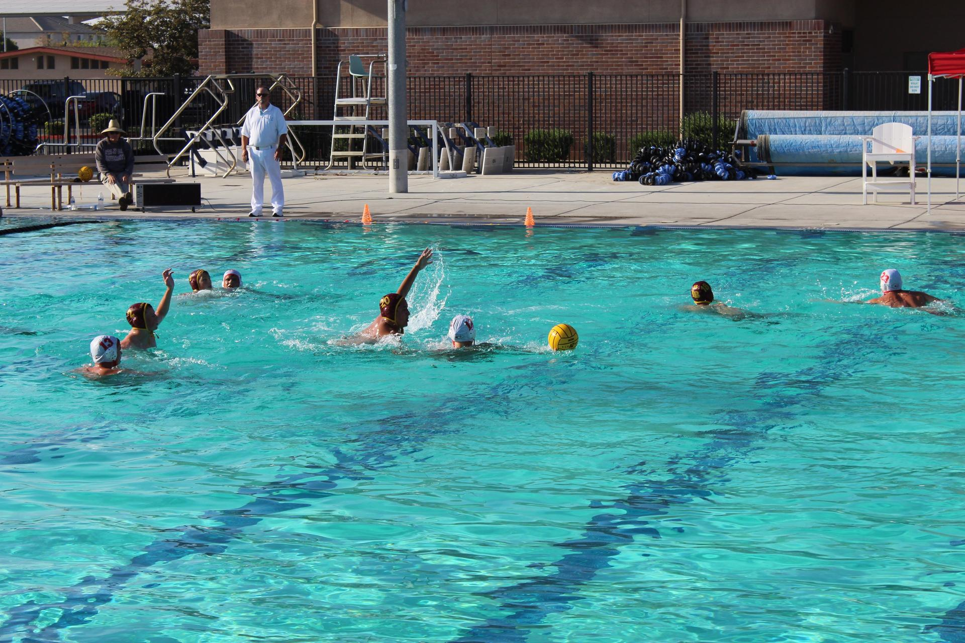 Water polo players in the pool vs Los Banos at Pacheco