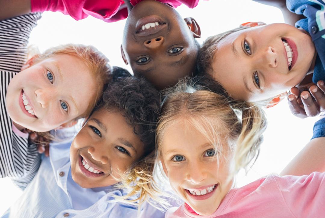 kids looking down at camera in circle