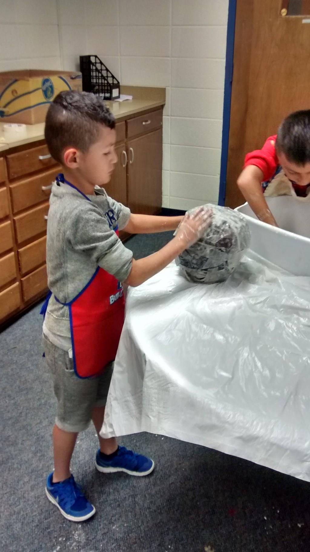 Student building planet