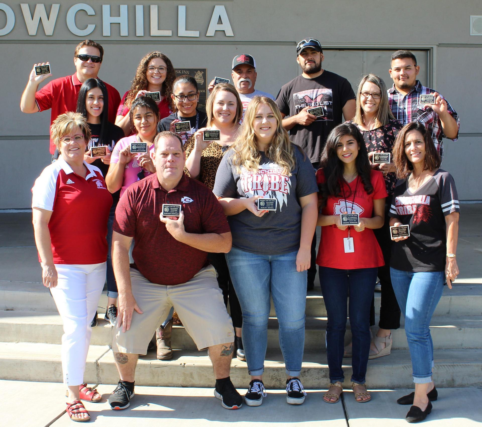 Staff receiving tenure with Mrs. Castillo