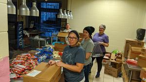 Volunteers help prepare meals