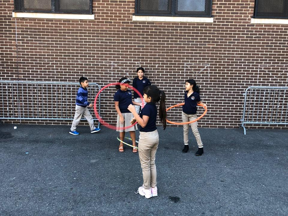 group of girls playing with hula hoops