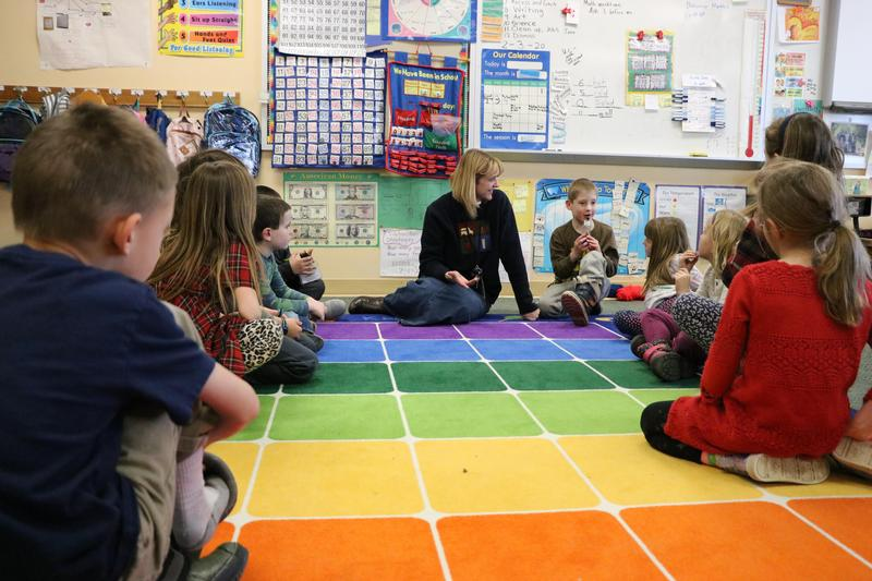 Teacher working with students on the carpet