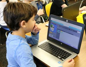 A student at Tamaques School enjoys coding activities during Computer Science Education Week.
