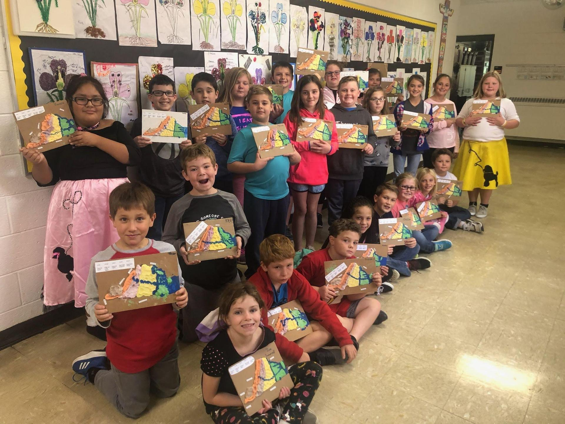 4th grade students display their salt relief maps of the state of Virginia