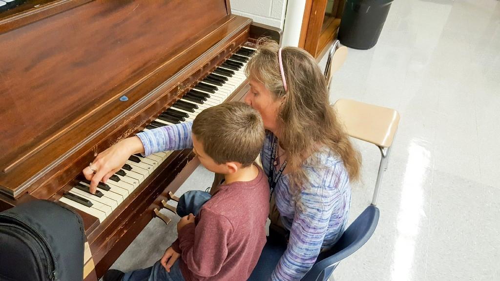 TA and student at Piano