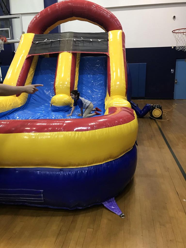 girl sliding down the bouncy house