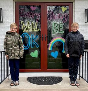 "Jefferson 5th graders (and twins) Nicholas and Rocco Dena unveil their colorful creation on the front door of their Westfield home, part of the Rainbow Project with elementary school principals enlisting families to ""brighten up our neighborhoods and our spirits."""
