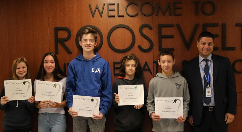 Photo of October Upstanders at Roosevelt Intermediate School, pictured with principal Brian Getchman.