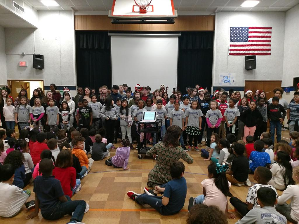 The Kelloggsville High School choir visited East Elementary in early December to perform and lead us in a holiday sing along.  The third grade Rocket Choir performed with them singing Silent Night as they sang a song called Peace, Peace.
