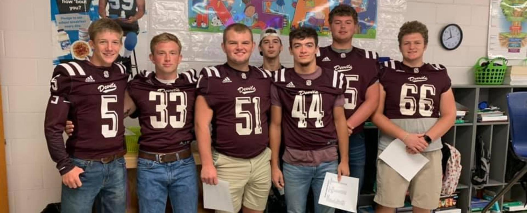 The Maroon Devil football players went to West to read to Elementary students!