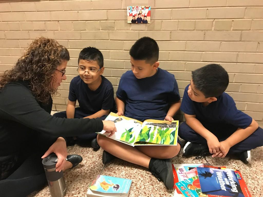 Ms. Freimuth assists students reading
