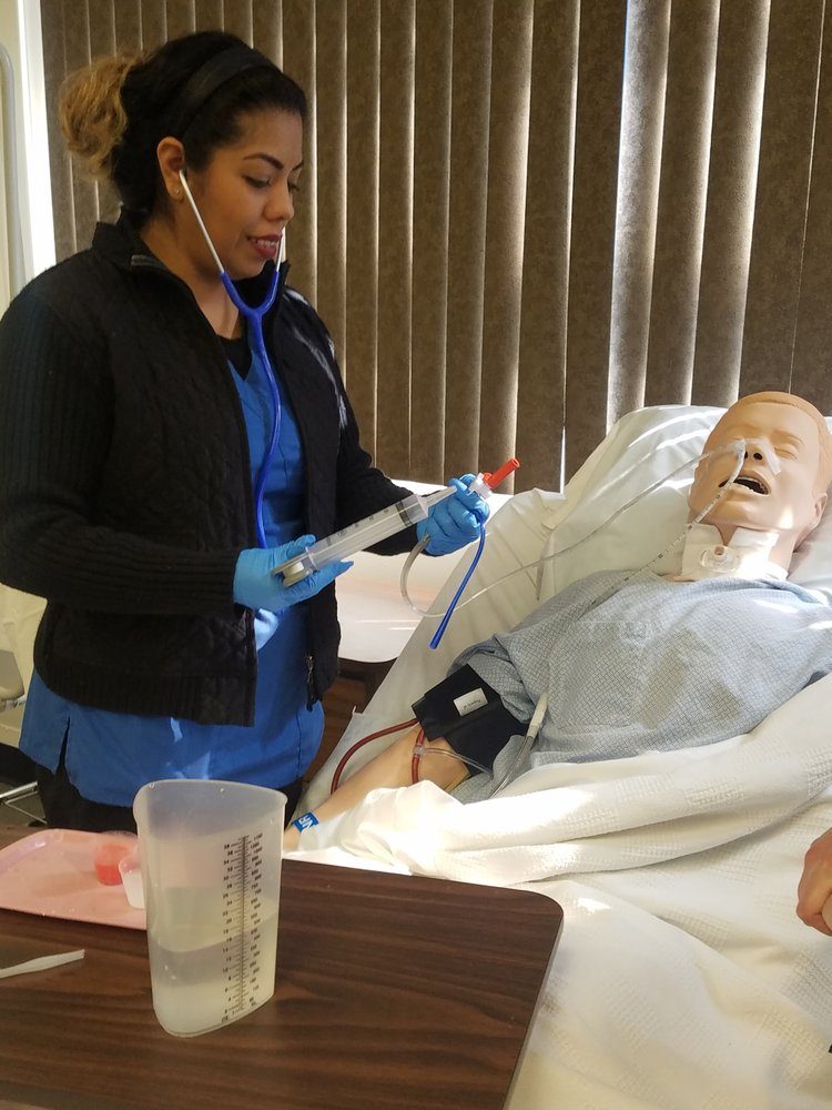 Nursing student with mannequin