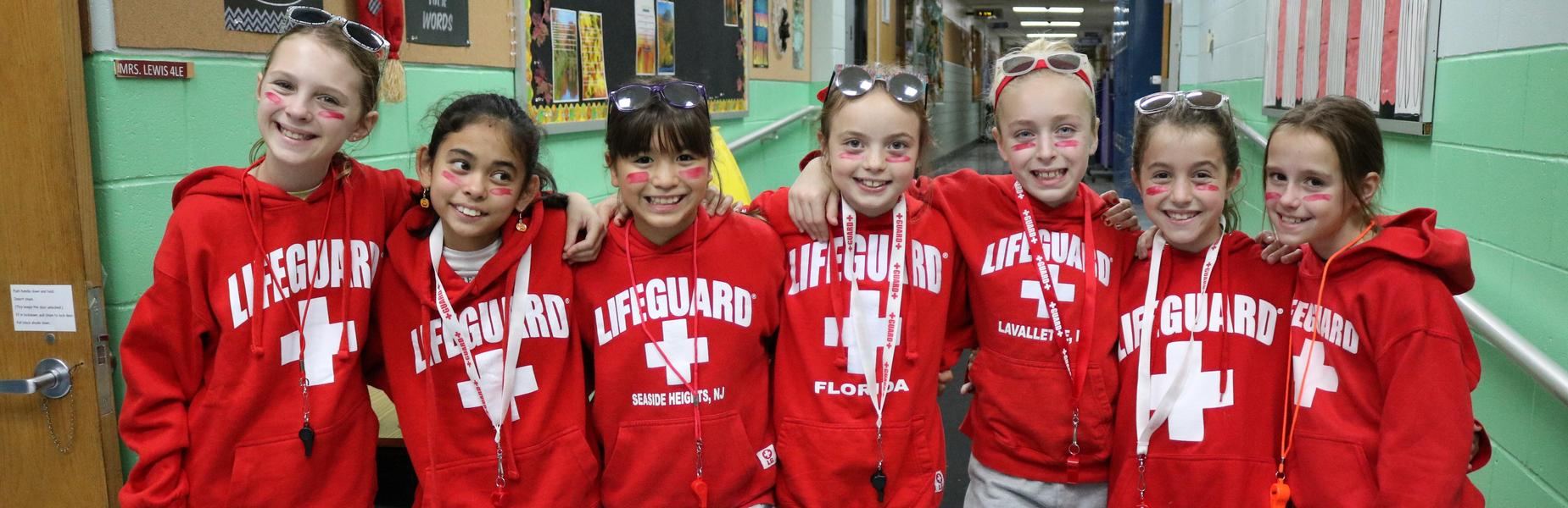 Photo of a group of Washington 5th grade girls dressed as lifeguards for Halloween.