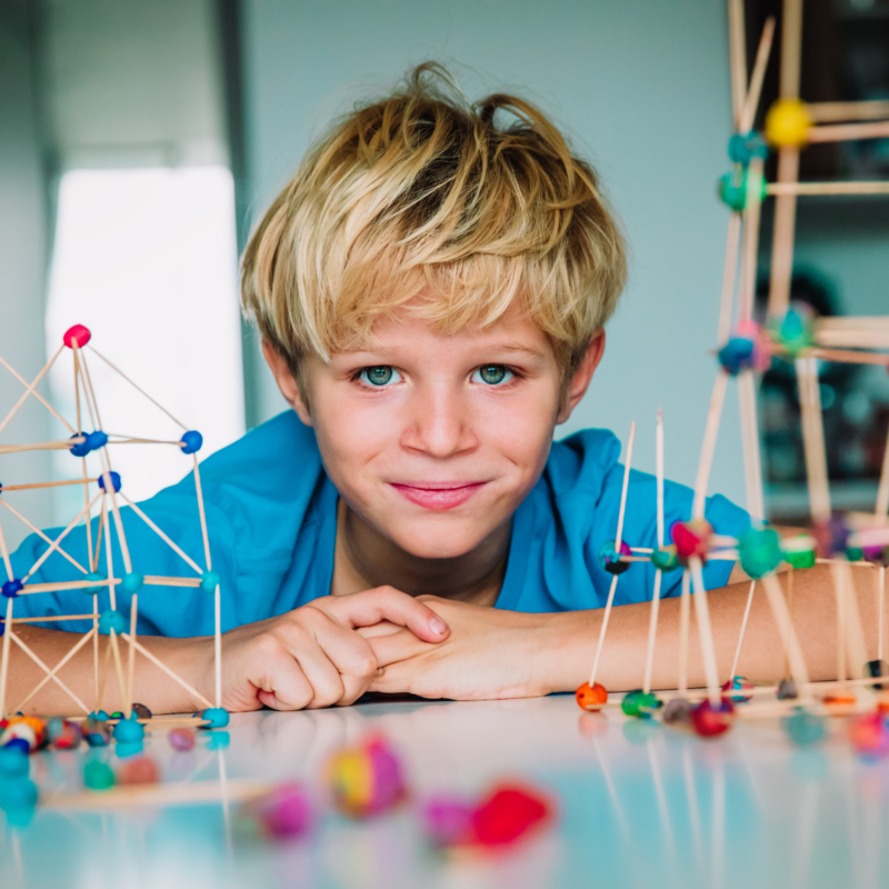 boy with stick building models