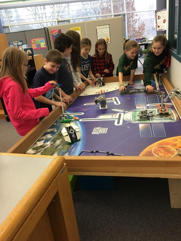 Students engaged with Lego spaceships.