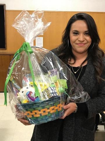 Parent holding gift basket