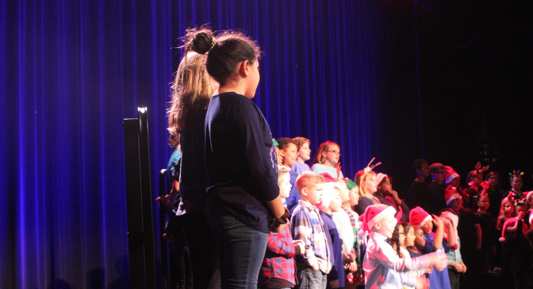The house of Revere singing at Christmas concert.