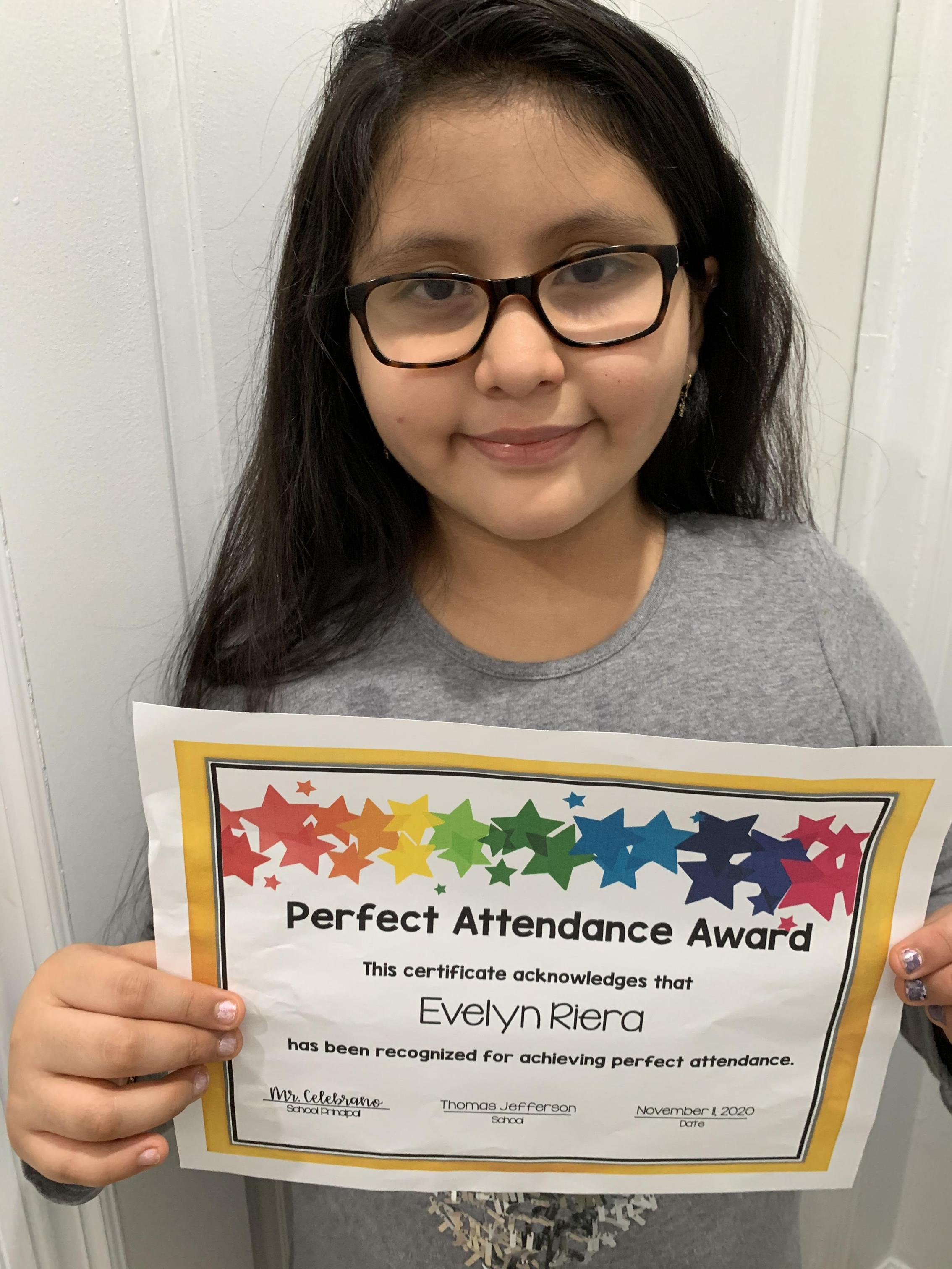 Evelyn Rivera holding perfect attendance certificate