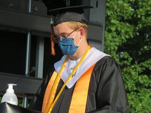 Facial coverings, social distancing and no handshakes were the norm at this graduation.