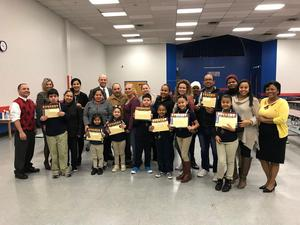 Edison Administration with the students of the month with their parents and parent liaison