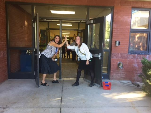 High five-ing in front of school