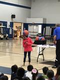 Student balancing a basketball