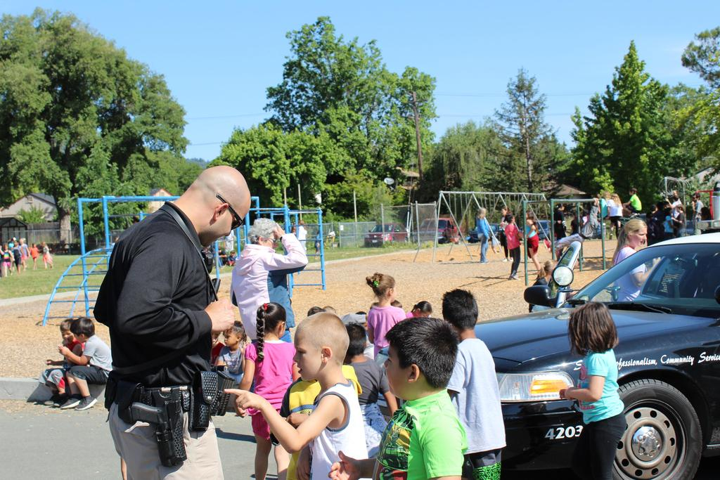 Field day, students learning about the Police Department