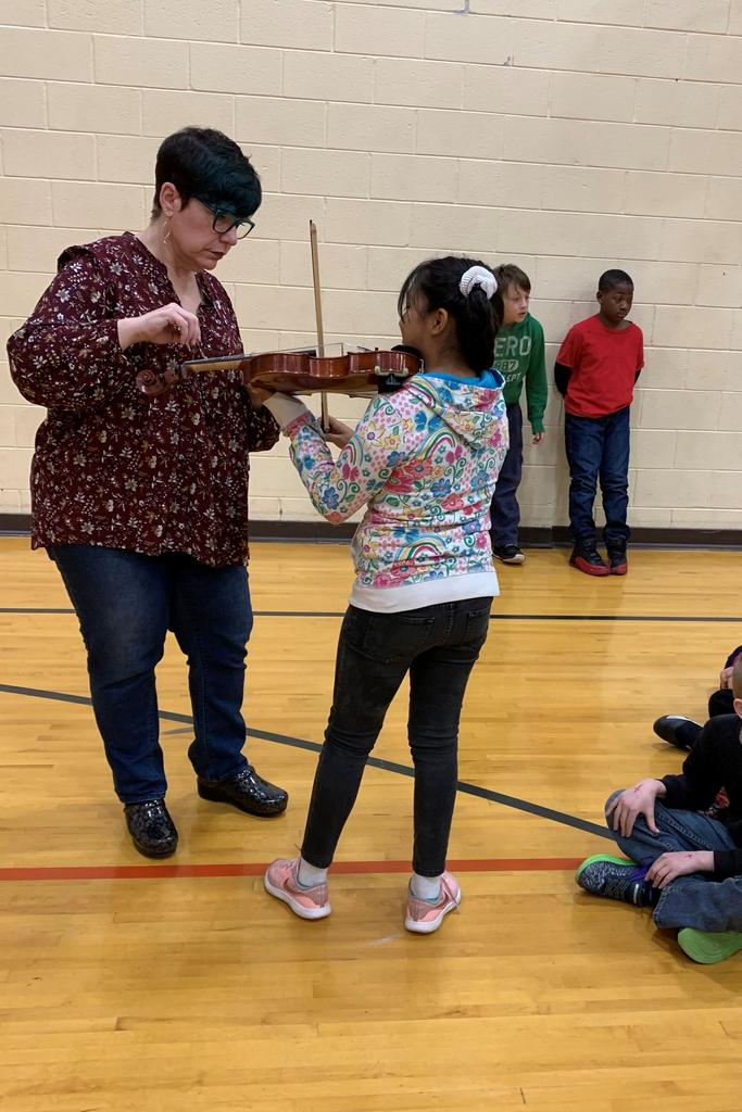Students learning about string instruments.