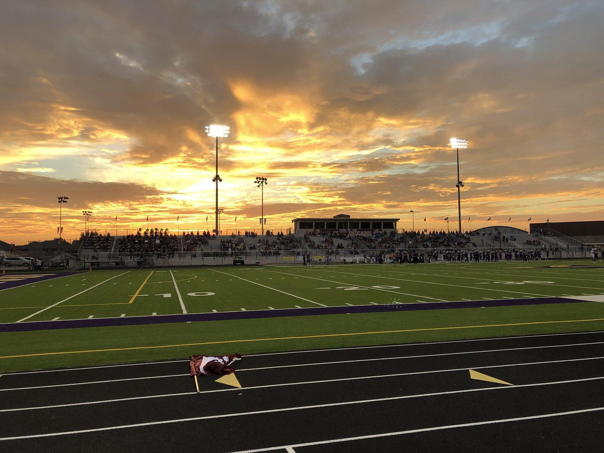 Friday Night Football Game with Sunset