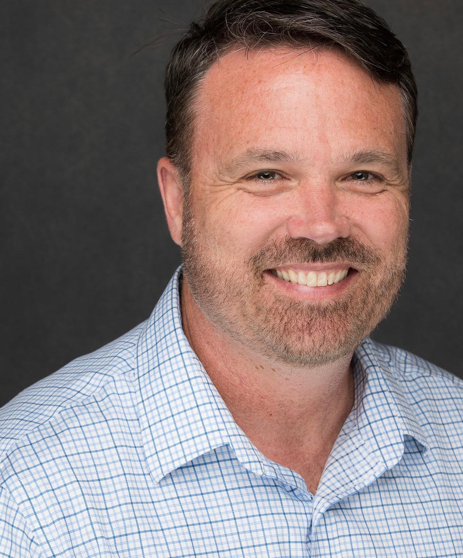 Headshot of Principal Beauchamp.
