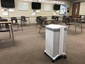 Photo of a new HEPA Machine in an empty classroom