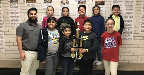 chess champions with trophy