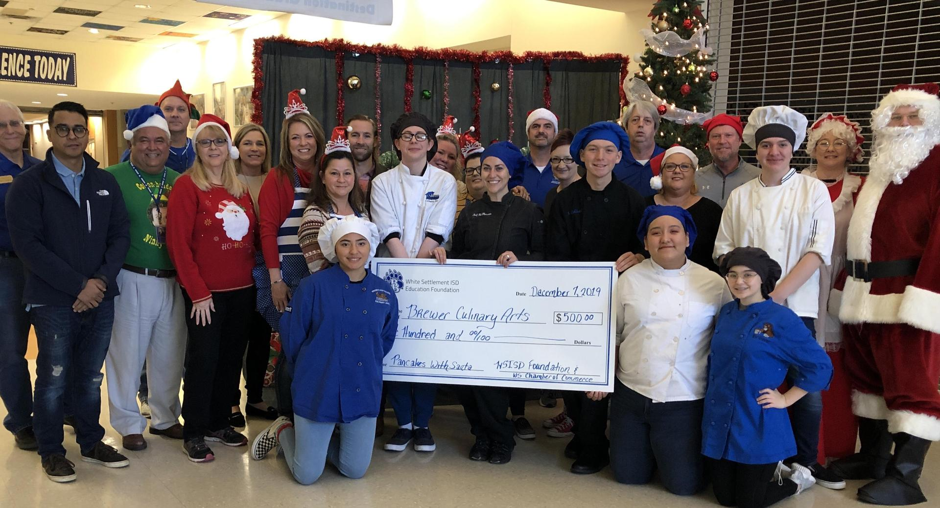 The WSISD Education Foundation and the White Settlement Chamber of Commerce sponsored the 4th annual Pancakes with Santa event on Dec. 7. The organizations awarded a portion of the proceeds ($500) to the Brewer High School Culinary Arts program, which fed 600 people a pancake breakfast.