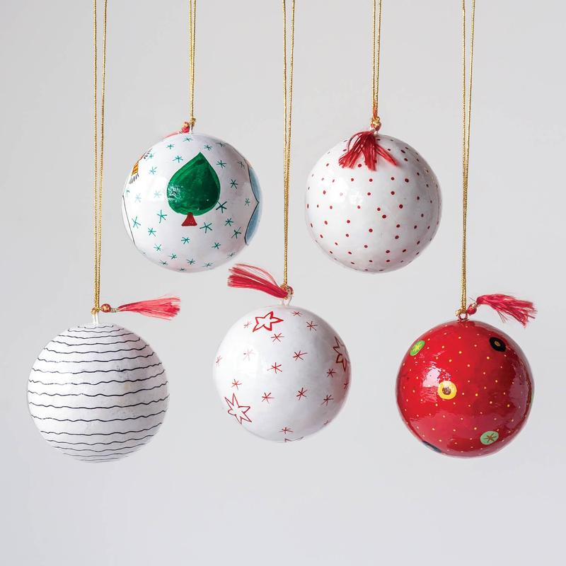 ornaments hanging in white and with green trees