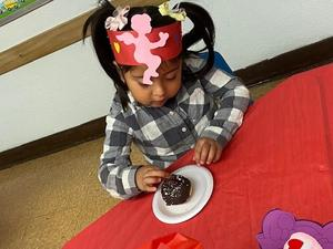 child enjoying cupcake