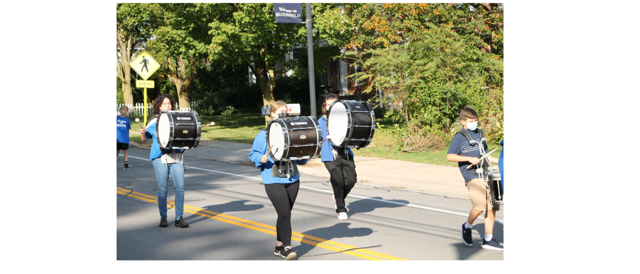 students marching while playing drums