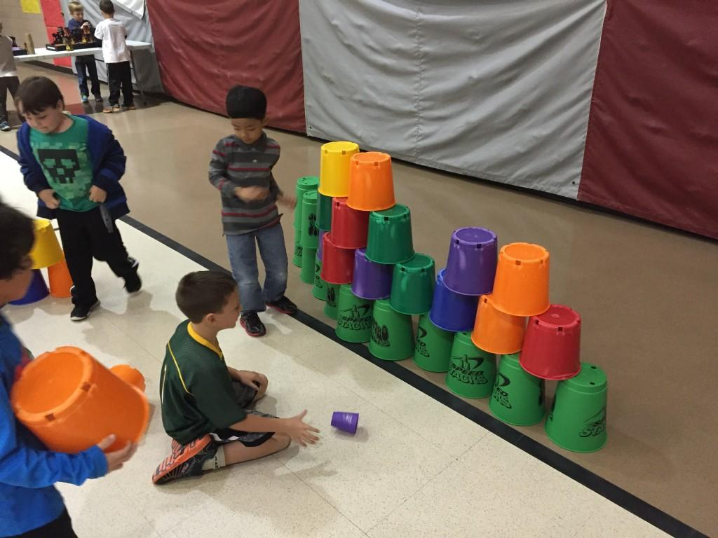 students compete to stack pails