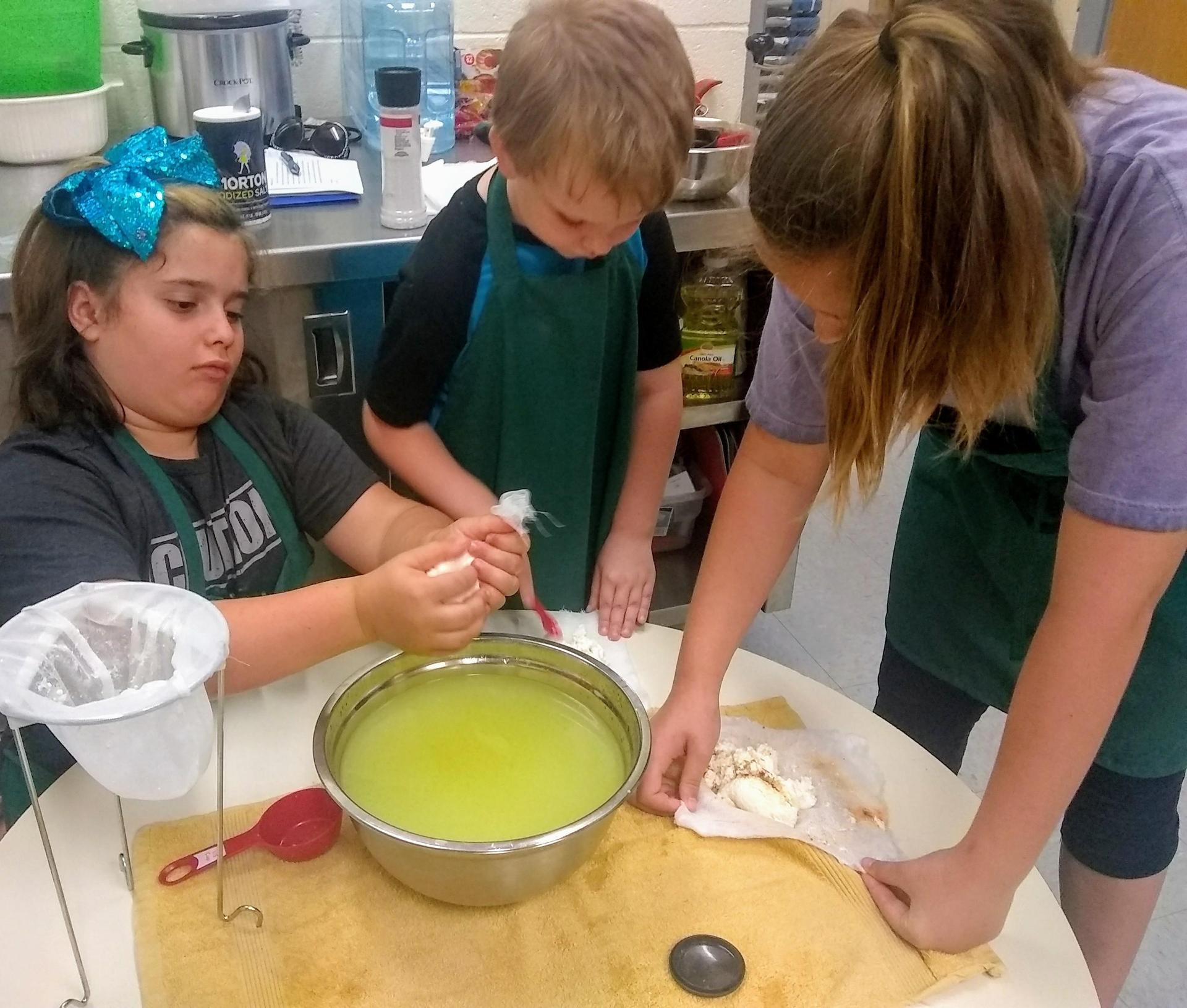 students sampling whey