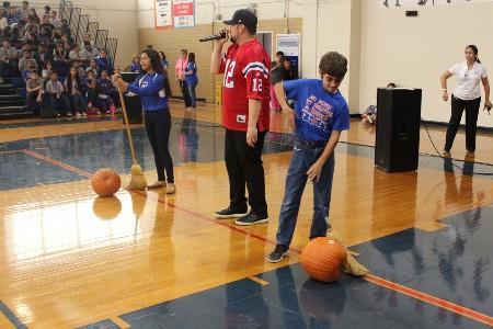 Two students getting ready for a rolling pumpkin competition during our Fall pep rally.