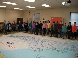 Students learning about the giant NC map.