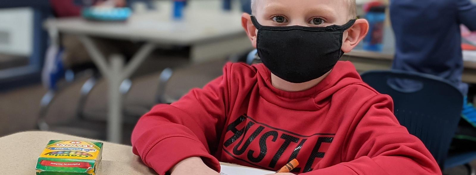 boy with mask on