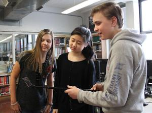Students and teachers at Edison Intermediate School participated in a recent beta test of a Google application that uses augmented reality technology to explore the inner workings of plant cells, the functions and framework of the human skeletal system, and other educational subjects.  Pictured here are three students enjoying the augmented reality app.