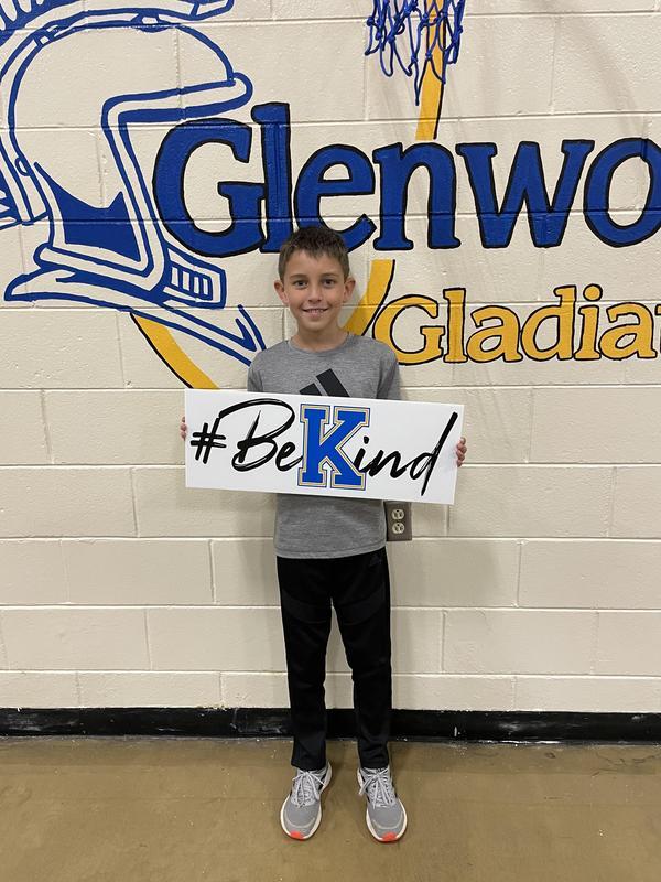 Keller holding sign