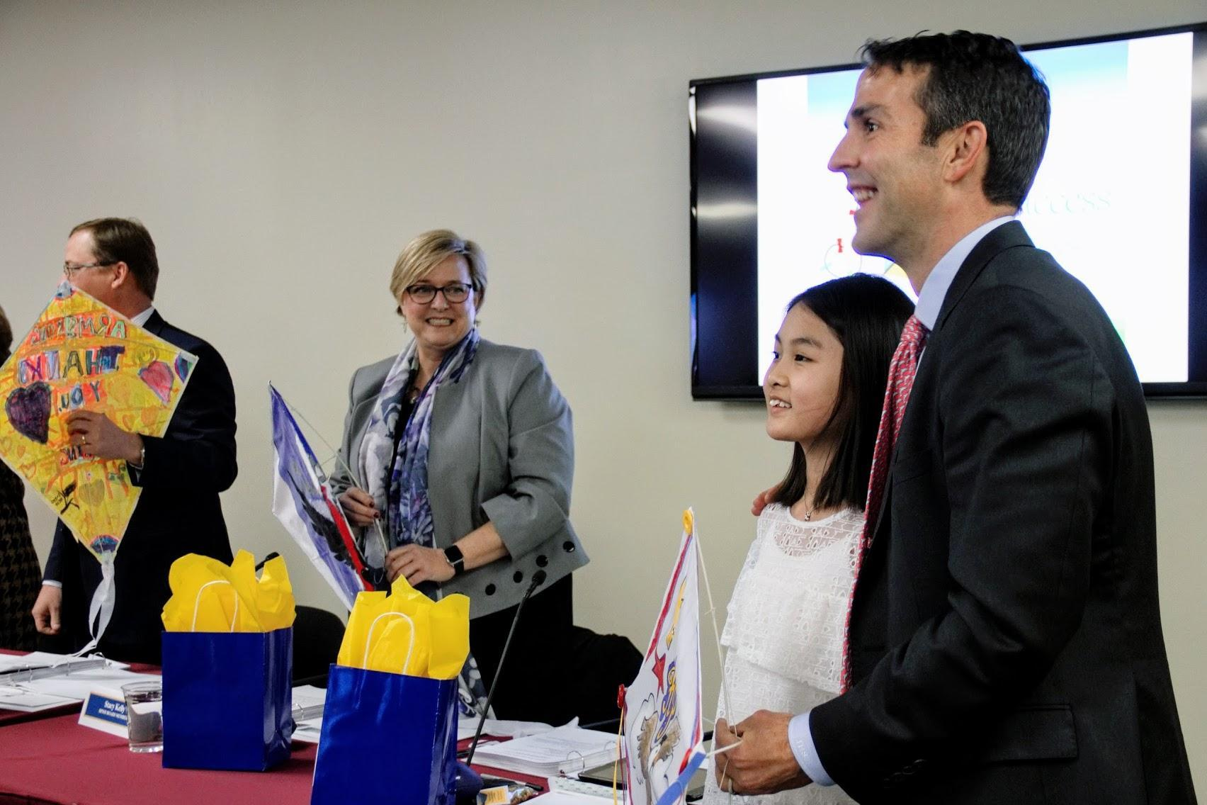 Board of Trustees accepting handmade kites of appreciation from students