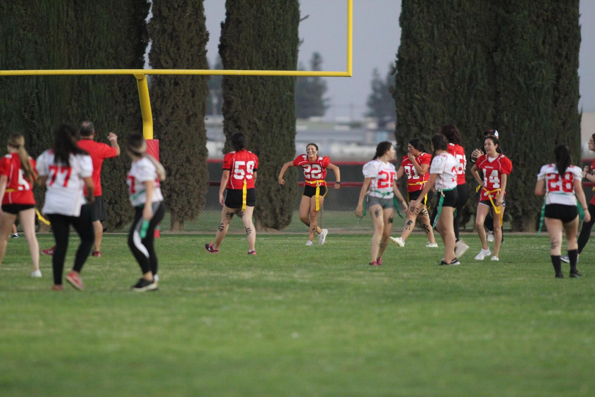 Students playing football at powder puff