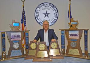 Coach Hooks and his trophies