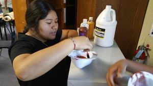 Students preparing paint