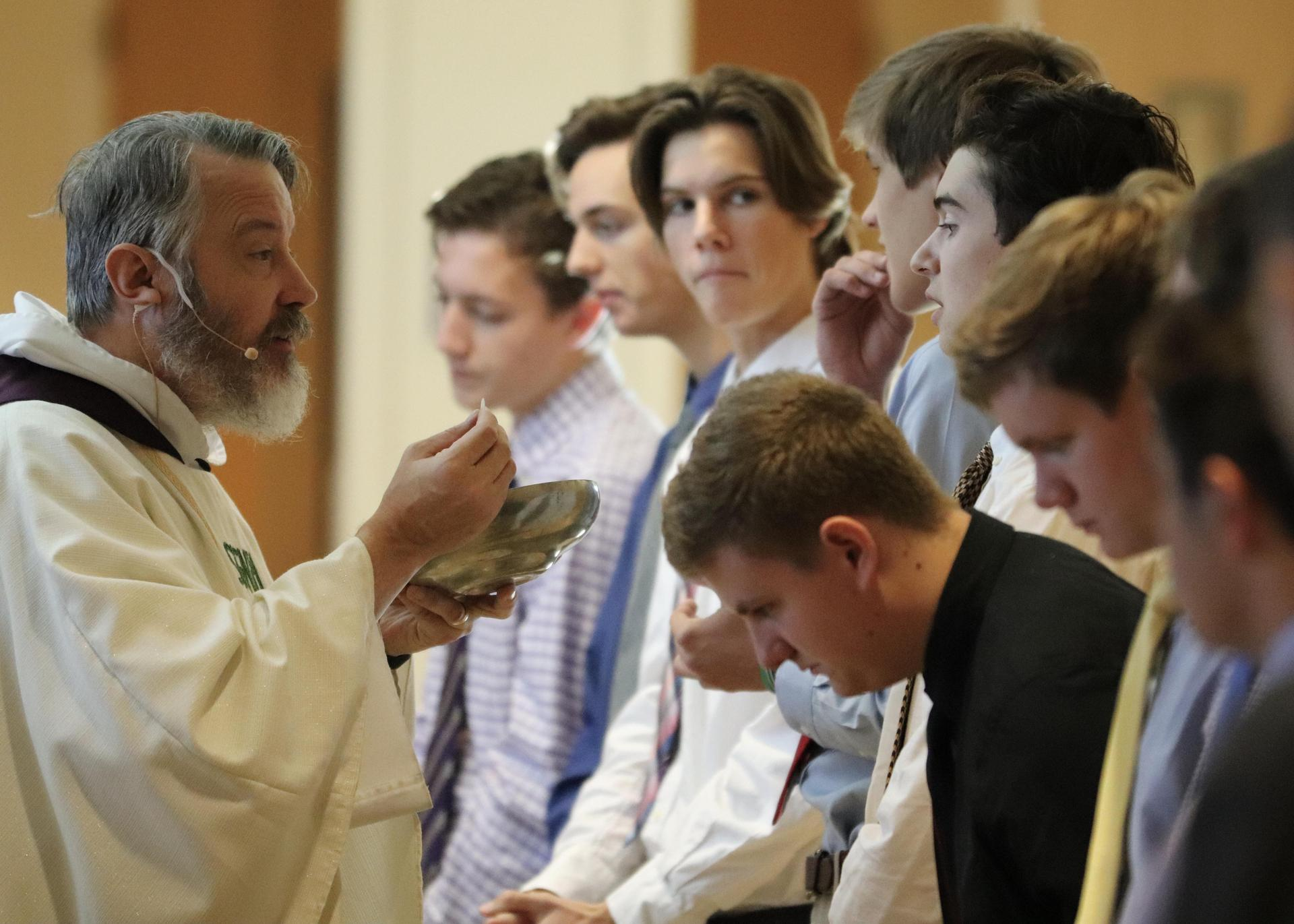 Father DePorres Durham with students