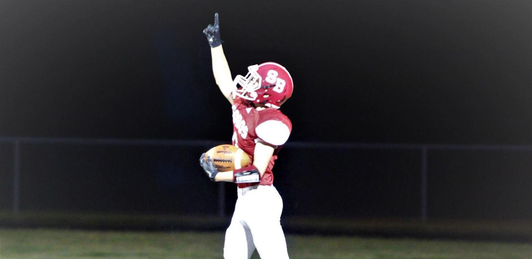 Football player pointing up